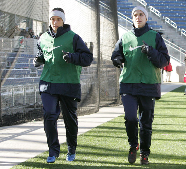 Morgan (right) and teammate Ali Krieger warm up during the first half of a playoff game against Italy during the 2011 FIFA Women's World Cup.