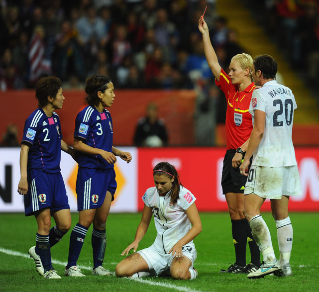 Japan's Azusa Iwashimizu is sent out by a referee for a foul on Morgan (center) during the FIFA Women's World Cup in 2011.