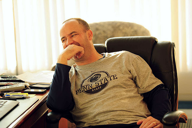 SI spent a 16-hour workday with Penn State coach Bill O'Brien and his staff last week as the Nittany Lions prepare for a very unusual season. The Jerry Sandusky scandal/cover-up wiped out most of the previous staff and left Penn State dealing with some of the harshest sanctions in NCAA history. On top of that, O'Brien must drag the program out of a time warp and into the current century. To read more about Penn State's reboot, pick up a copy of this week's  Sports Illustrated  magazine.  In this first photo, O'Brien enjoys a lighter moment as dawn breaks on Aug. 16. O'Brien typically begins his workday before the sun rises.