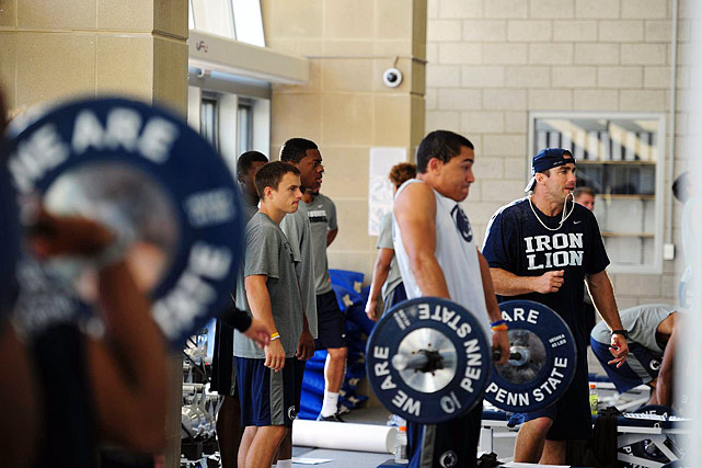 The new Penn State strength staff, led by Craig Fitzgerald, has added more Olympic lifts to the training menu. Here, players complete a high shrug following a dead lift -- which followed a power clean.