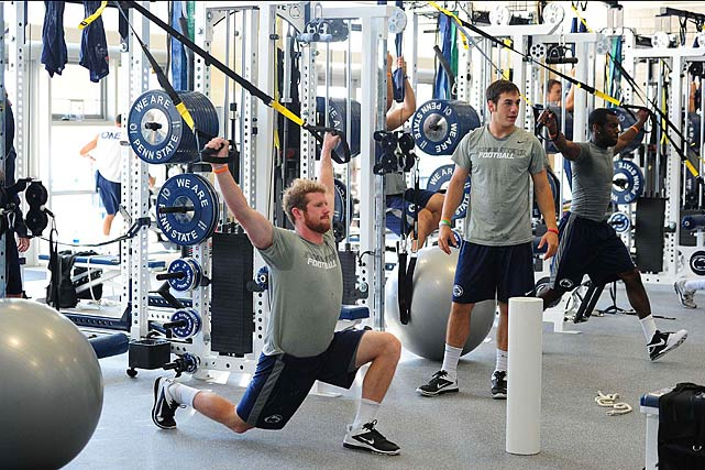 Penn State quarterback Matt McGloin completes another compound move during a workout. This one requires players to pull heavy elastic bands while also performing a lunge.