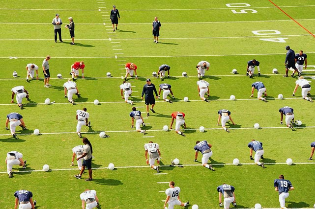 Penn State players stretch before practice on Aug. 16.