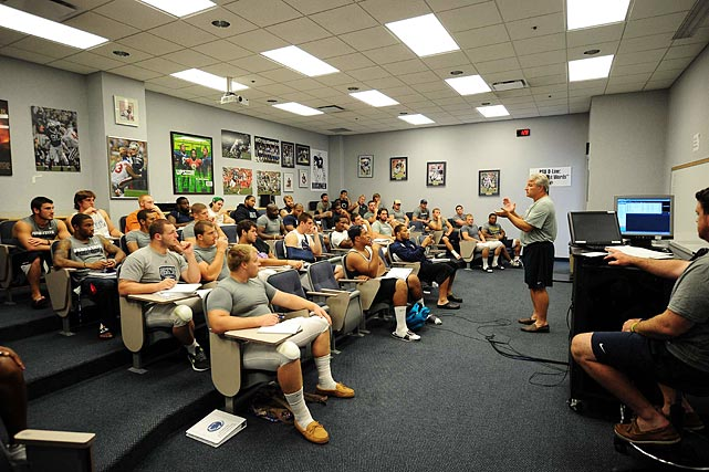 Penn State defensive coordinator Ted Roof meets with his players before practice on Aug. 16. Roof ran the defense at Auburn from 2009-11. He had planned to coach the defense at Central Florida in 2012, but he was hired at Penn State by head coach Bill O'Brien, who worked under Roof when Roof was head coach at Duke.