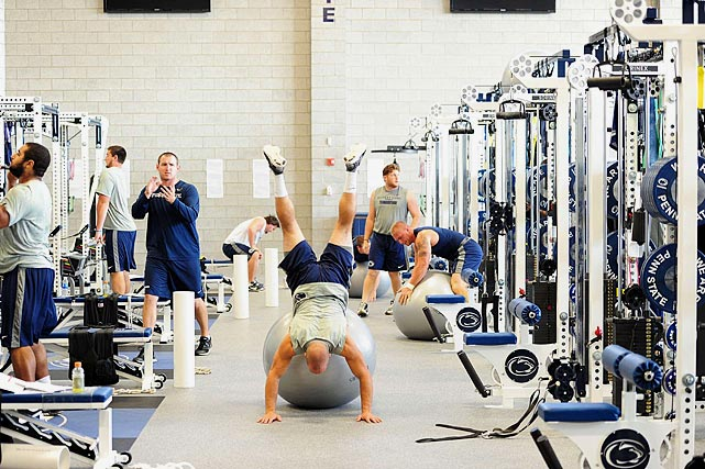 In between weight sets during a Penn State workout, players also work on balance.