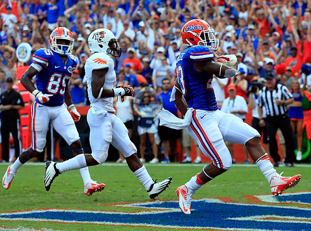 It was closer than expected, but Florida escaped with a victory over Bowling Green in Week 1. The Gators trailed 7-0 entering the second quarter, but outscored the Falcons 27-7 over the final 40 minutes to move to 1-0 on the season. Running back Mike Gillislee (pictured) took the lead, accumulating 148 rushing yards and two touchdowns.