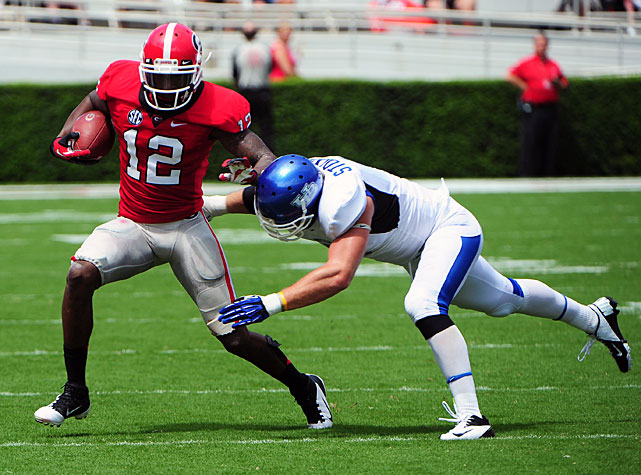 Despite carrying a slim 24-16 lead into intermission, Georgia held off Buffalo for a 45-23 win. Quarterback Aaron Murray passed for 258 yards and three touchdowns, and wideout Tavarres King (pictured) made six catches for 117 yards and a score. The road doesn't get easier for Georgia, though. Mark Richt's squad plays Missouri next Saturday in the Tigers' SEC debut.