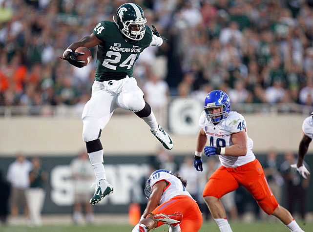 Le'Veon Bell (pictured) carried Michigan State to victory, amassing 265 all-purpose yards -- 210 rushing, 55 receiving -- in the Spartans' opening-week win. The Spartans outgained the Broncos 461 yards to 206, but allowed Boise State to stay in the game after three interceptions from quarterback Andrew Maxwell. Broncos quarterback Joe Southwick completed 15-of-31 passes for 169 yards in his first start as Kellen Moore's successor.