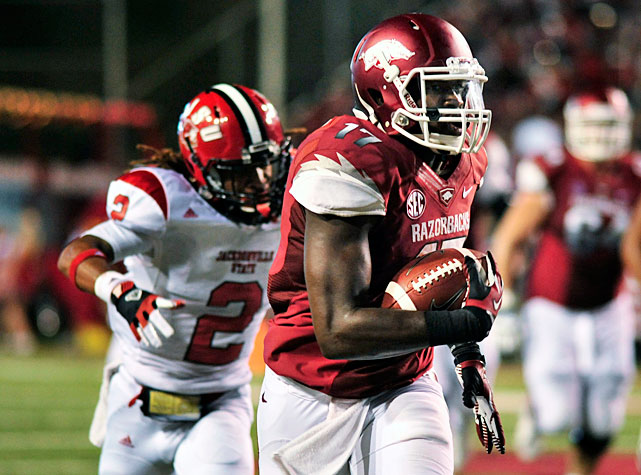 Fueled by a 28-point second quarter, Arkansas easily dispatched of Jacksonville State in Week 1. Tyler Wilson completed 19-of-27 passes for 367 yards and three touchdowns, and running back Knile Davis led all rushers with 70 yards a score.  Two Razorbacks wideouts surpassed the 100-yard plateau: Chris Gragg, who racked up 110 yards and two touchdowns, and Brandon Mitchell (pictured), who finished with 122 receiving yards.