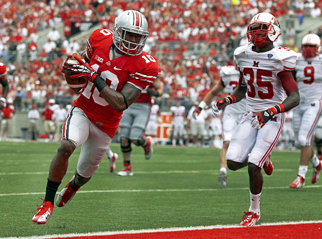 Urban Meyer's tenure at Ohio State got off to a terrific start, as the Buckeyes walloped Miami (Ohio) in Columbus. Sophomore quarterback Braxton Miller accounted for 370 all-purpose yards -- 207 passing, 163 rushing -- and three touchdowns, and Corey Brown (pictured) paced the wideouts with 87 receiving yards and a score.  After falling behind 3-0, Ohio State rattled off 35 consecutive points in the victory.