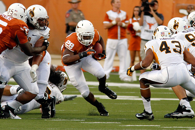 After winning the starting job in training camp, Texas quarterback David Ash said he'd be happy to hand off and get out of the way if it meant the Longhorns would win. Good plan. Malcolm Brown (No. 28) and Joe Bergeron both rushed for more than 100 yards and combined for three touchdowns to power Texas.