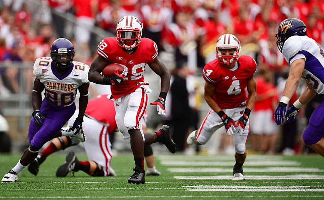 Montee Ball (pictured) was typically productive, but Wisconsin required a late defensive stop to preserve a Week 1 win over Northern Iowa. Ball rushed for 120 yards and a touchdown, but the Badgers almost watched a 26-7 lead slip away by surrendering 14 consecutive points in the fourth quarter. Wisconsin defensive lineman Ethan Hemer ended the Panthers' upset bid by batting away a Sawyer Kollmorgen pass on fourth down with 3:18 remaining.