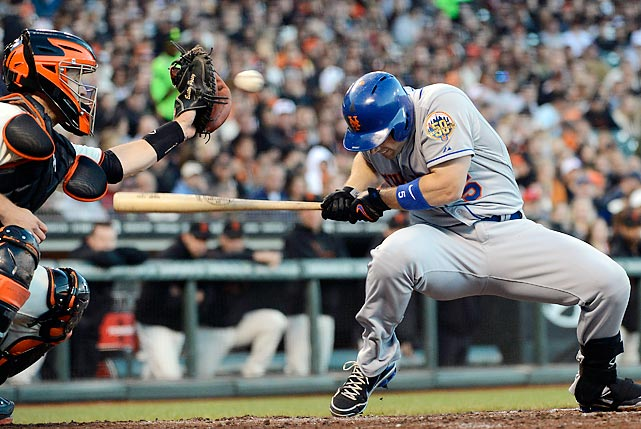 David Wright of the New York Mets dives out of the way of this pitch at AT&T Park in San Francisco.