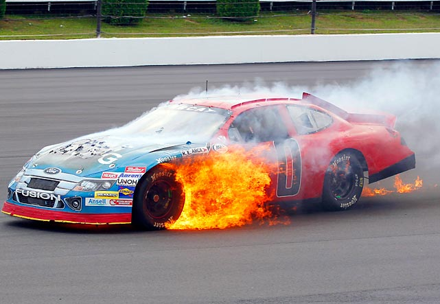 Don Thompson's burning car continues down the track on the eighth lap during the ARCA race in Long Pond, Pa.