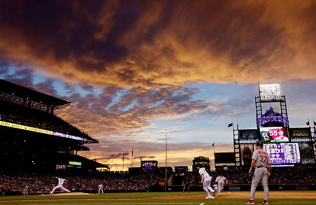Adam Ottavino of the Rockies pitches underneath a scenic sky in Colorado as the Rockies took on the St. Louis Cardinals.