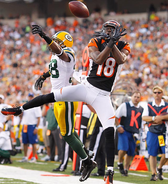 Green Bay's Tramon Williams attempts to break up a pass intended for Cincinnati's A.J. Green in an NFL preseason game in Cincinnati. The Packers defeated the Bengals 27-13.