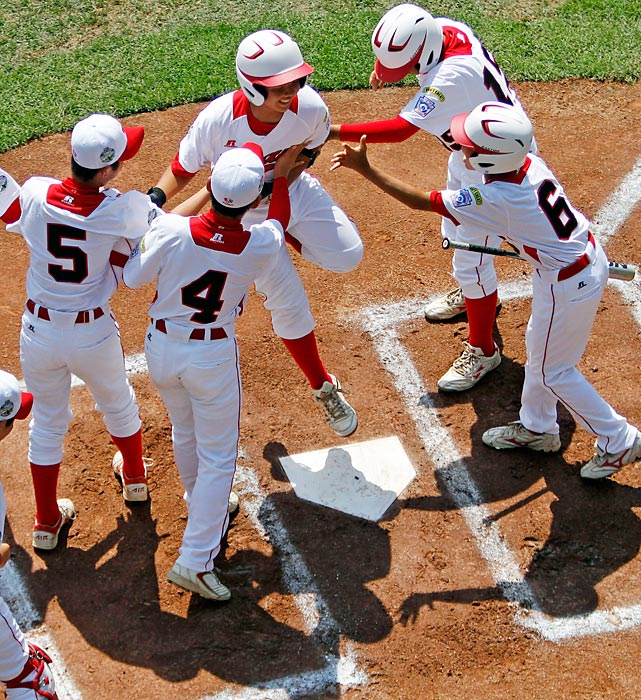Tokyo's Satoru Aoyama  celebrates with teammates after hitting a solo home run off of Panama, pitcher James Gonzalez in the first inning of the international championship at the Little League World Series. After beating Panama, 10-2, Japan would defeat Goodlettsville, Tennessee in the series final, 12-2.