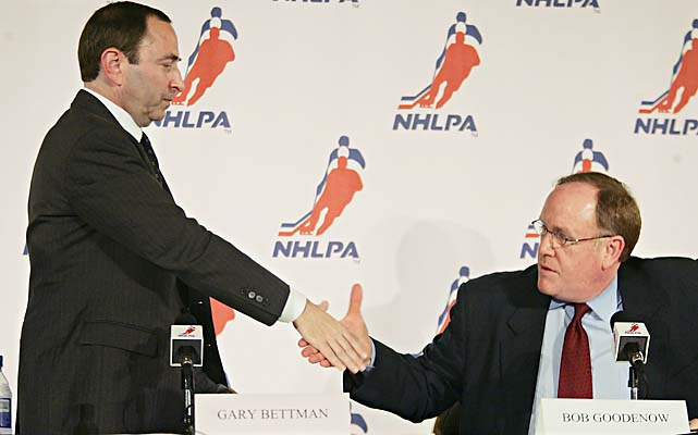 Bettman, left, shakes hands with NHLPA Executive Director Bob Goodenow after the players agreed to a labor settlement on July 21, 2005.