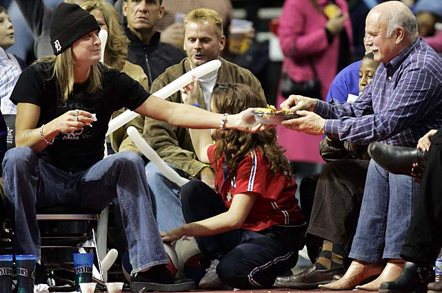 Kid Rock offers nachos to Hurricanes owner Peter Karmanos during a January 2005 game between the Pistons and Knicks. The Pistons won 91-61.