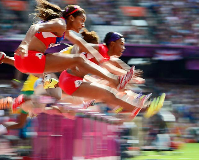 Gold-medal hopefuls competed Monday in qualifying heats for the 100-meter hurdles semifinals.