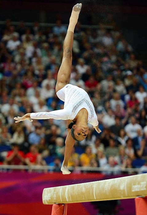 Gabby Douglas, Olympic gold medalist in individual all-around, performed on the balance beam but had a disappointing fall, eliminating her chances for another medal.
