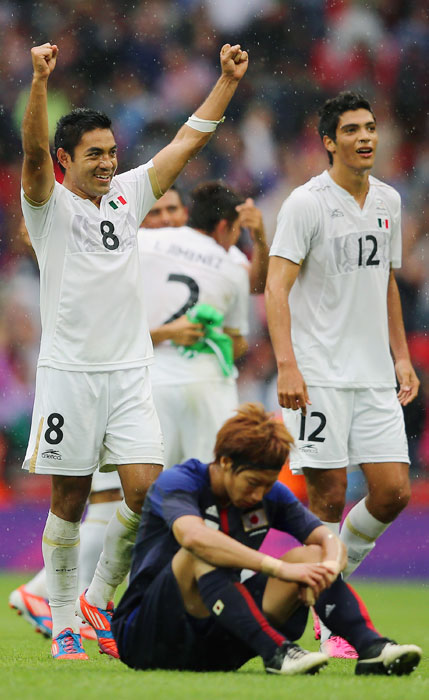 Marco Fabian of Mexico celebrates his team's 3-1 comeback victory over Yuki Osto and Japan in a semifinal soccer game. Mexico will play Brazil for the gold medal.