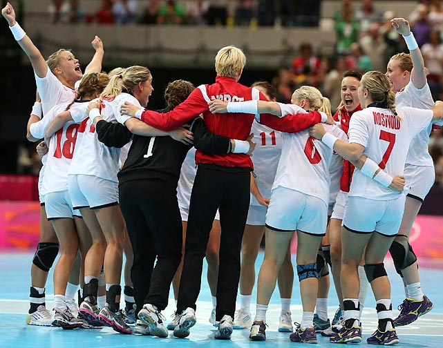 Norway's women's handball team celebrates after defeating Brazil and advancing to the semifinals.