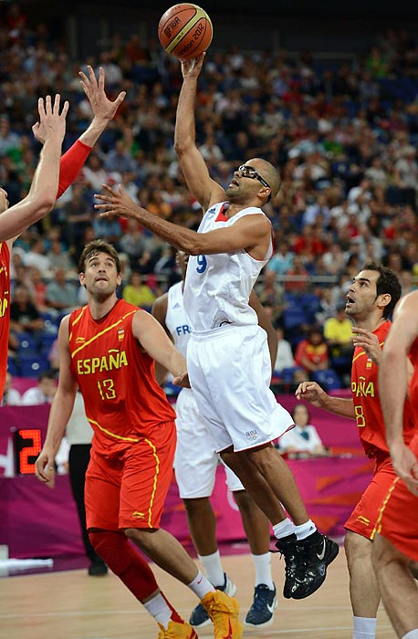 Tony Parker goes up for a shot as France took on Spain in Olympic basketball action Wednesday. Spain ultimately defeated France, advancing to a semifinals match against Russia.