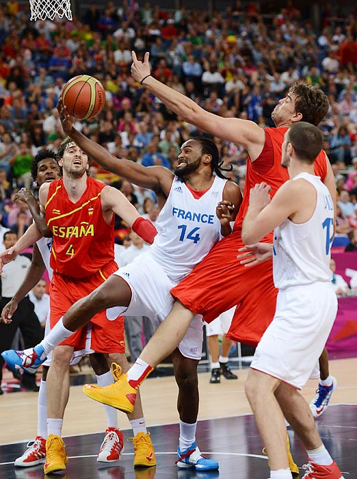 France's Ronny Turiaf tried to split brothers Pau (4) and Marc Gasol in a quarterfinal matchup with Spain but failed to score. Spain won 66-59 to advance to the semifinals.
