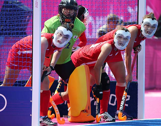 In their team's 4-1 field hockey loss to Germany, South Korea's (from left) Cha Sena, Jang Soo Ji, Han Hye Lyoung and Kim Young Ran donned mask-imum protection on a penalty corner.