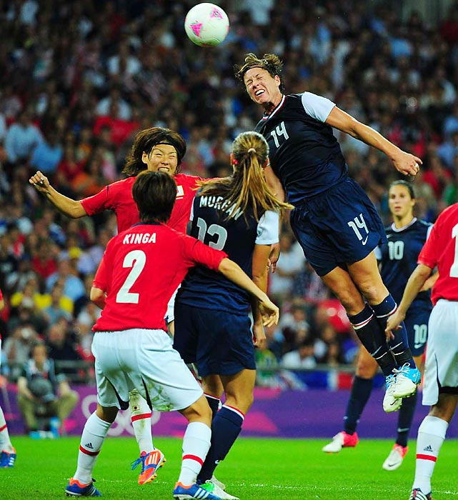 Abby Wambach goes up for a header in a game in which the U.S. jumped to a 1-0 lead early and held on to avenge their 2011 World Cup loss to Japan.