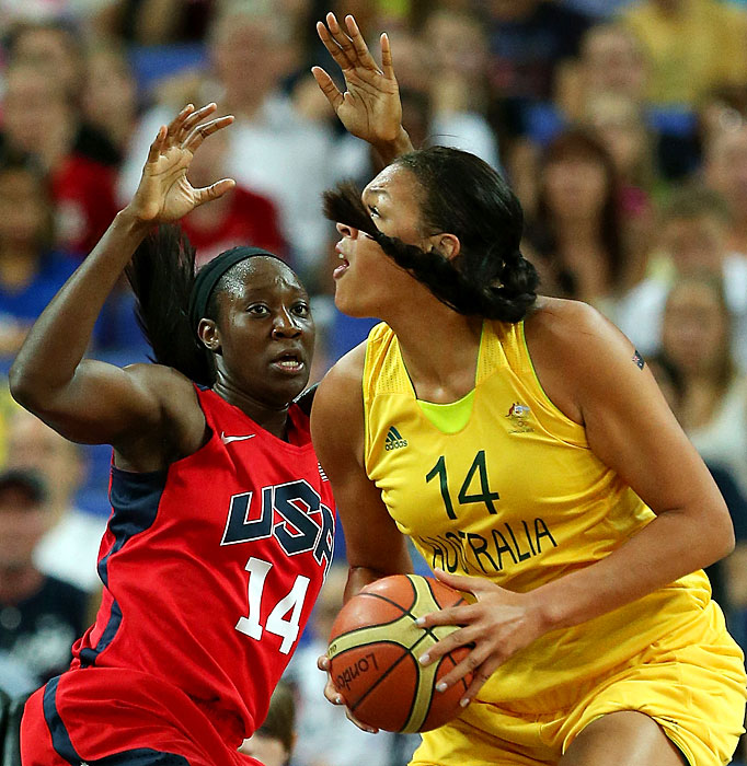 Tina Charles of the U.S. defends against Australia's Liz Cambage during their semifinal matchup. The U.S. recovered from a halftime deficit to win 86-73 and advance to the gold medal game.