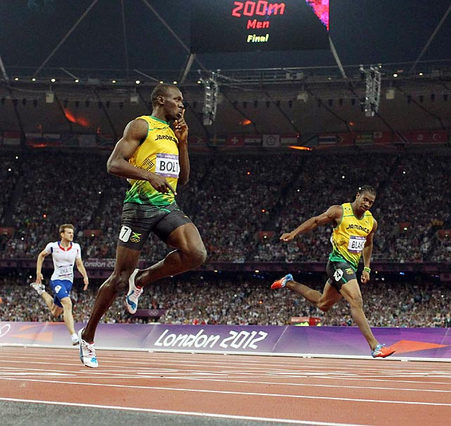 Usain Bolt easily won the 200-meter dash on Thursday, becoming the first man to repeat as 100 and 200 champion in consecutive Olympics.