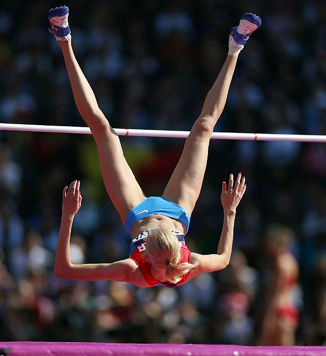 Irina Gordeeva of Russia jumps up and over the bar to qualify for the next round in the high jump.  Gordeeva cleared the height of 1.93 meters.