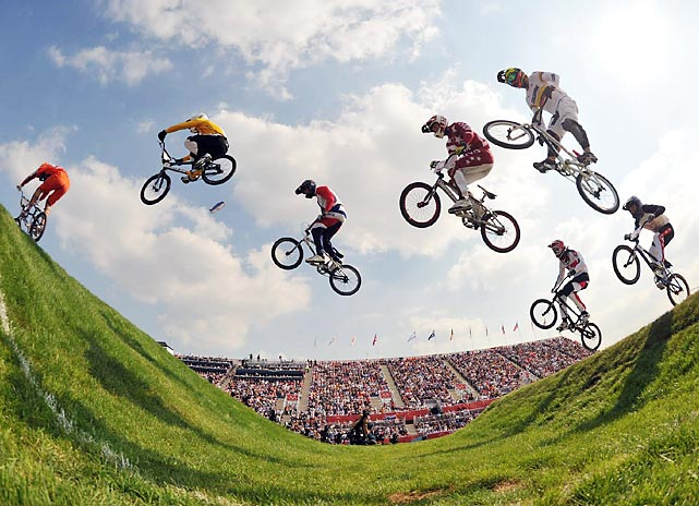 Forming an E.T.-like tableau, cyclists soared through semifinal 2 of the men's BMX track competition. Aussie Sam Willoughby (yellow) took the semi, but Latvia's Maris Strombergs (in red) would edge him for first in the final.
