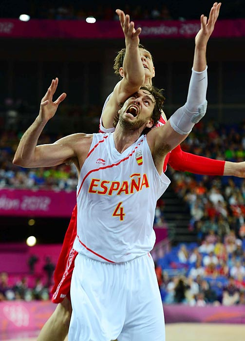 Russia's Timofey Mozgov got the upper hand (and upper arm) on Pau Gasol of Spain -- though Gasol got the rebound -- in their semifinal game, which Spain won.