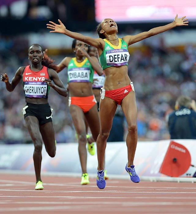 Ethiopia's Meseret Defar embraced the moment as she crossed the line to take the 5,000 meters, reclaming the title she'd won in 2004, as Vivian Cheruiot of Kenya took silver and Tirunesh Dibaba, the '08 champ (and London 10,000-meter gold medalist) earned the bronze.