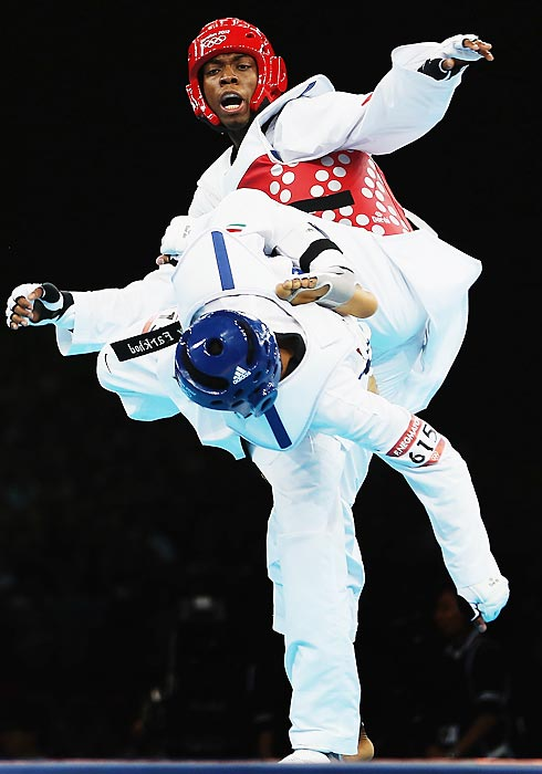 Great Britain's Lutalo Muhammad competes against Tajikistan's Farkhod Negmatov during the preliminary round of the men's 80kg taekwondo.