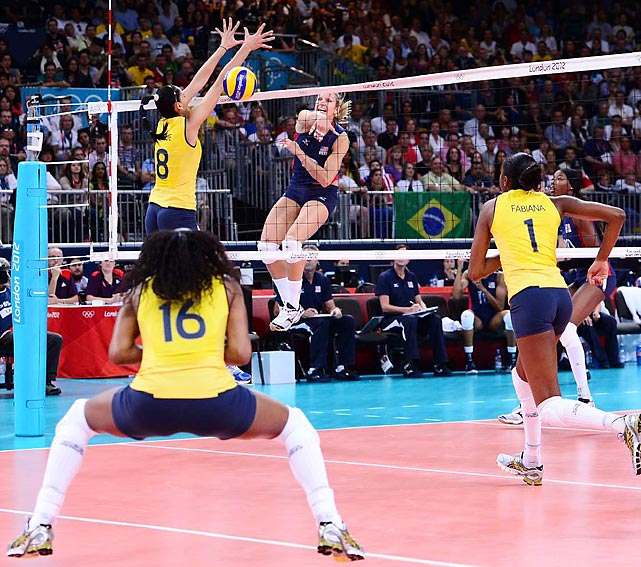 The U.S.'s Christa Harmotto drilled the ball past Brazil's Jaqueline Carvalho in the volleyball final, but the Brazilians took the gold medal in four sets.