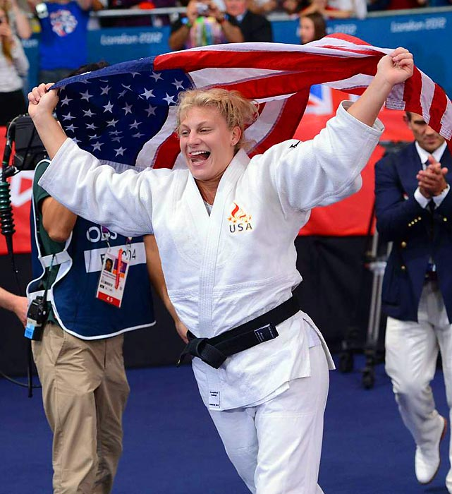 Kayla Harrison basked in Old Glory after defeating Britain's Gemma Gibbons to end a long personal saga and earn the U.S.'s first-ever gold medal in judo.