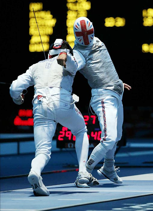 Alaaeldin Abouelkassem (left) outtouched Britain's Richard Kruse 6-5 in their men's team foil match, but the British claimed victory, 45-33.