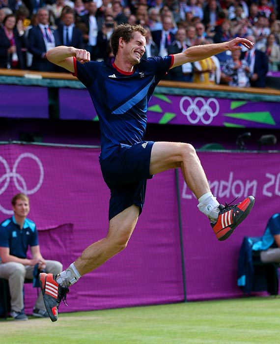 Andy Murray of Great Britain celebrates winning the singles gold medal over Roger Federer.