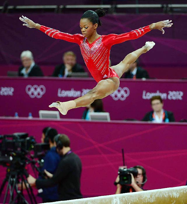 Douglas leaps on the balance beam during team finals at the 2012 London Games. The true team anchor, Douglas was the only gymnast to compete in all four events for Team USA.