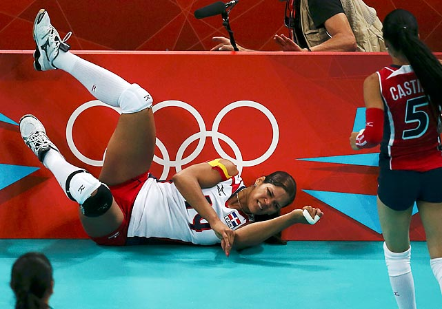 The Dominican Republic's Altagracia Rivera Brens collides with the barrier during a Group A volleyball match.