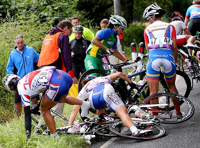 Four women cyclists try to detangle and recover after a collision that resulted in a pileup during the road race.