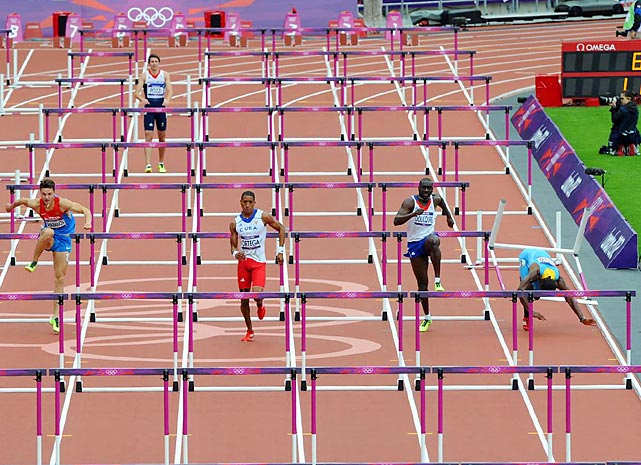 Shamar Sands (far right) trips and falls during the 110-meter hurdles preliminary, ending his gold medal pursuit.
