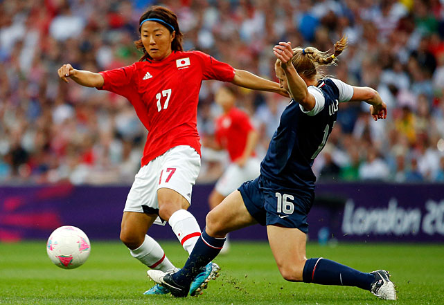 Yuki Ogimi of Japan moves the ball against Rachel Buehler of the United States in the first half.