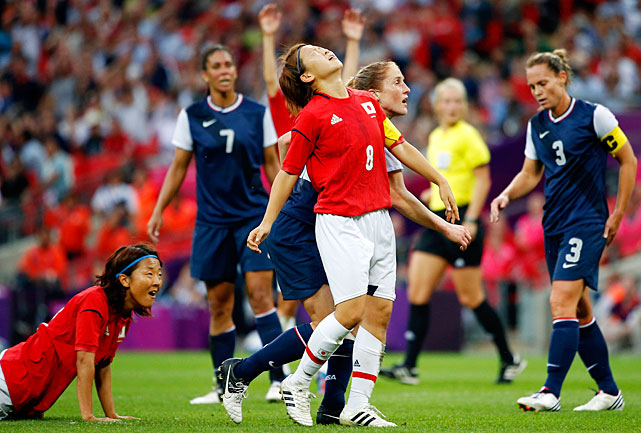 Aya Miyama of Japan reacts after hitting the cross bar on a shot in the first half against the United States.