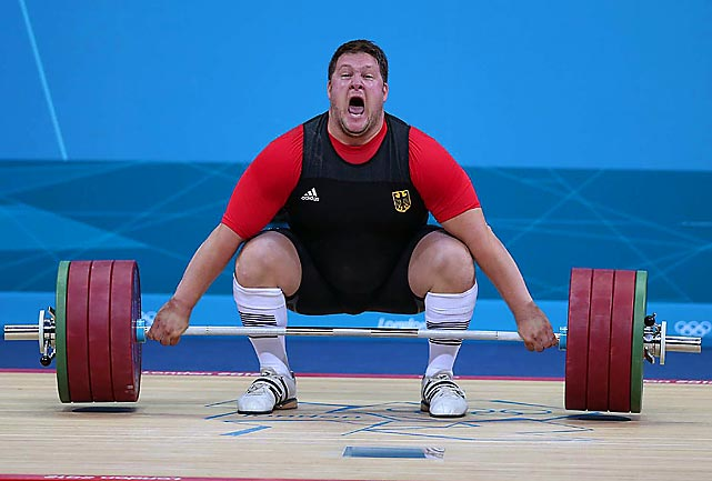 Defending Olympic weightlifting champion Matthias Steiner of Germany lost his balance while trying to lift about 432 pounds and was hit in the neck by the barbell. He got up on his feet and waved to the crowd but later withdrew from the competition. Here's a sequence of photos by SI photographer Simon Bruty.