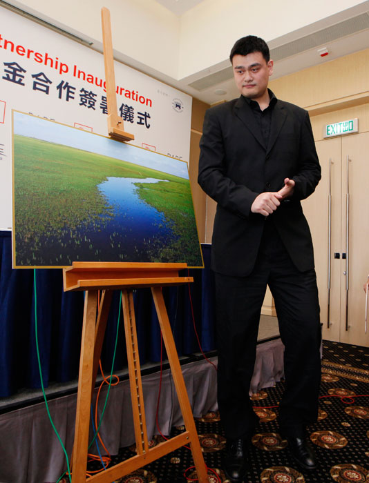 Yao attends a signing ceremony for a partnership between a pro-environment and conservation group, RARE and Yao Foundation in Hong Kong.