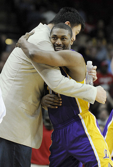 Yao greets former teammate (and current Laker) Metta World Peace before a Rockets-Lakers game.